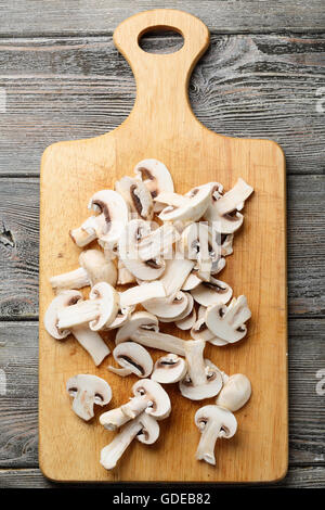 fresh sliced white button mushrooms, food top view - Stock Photo