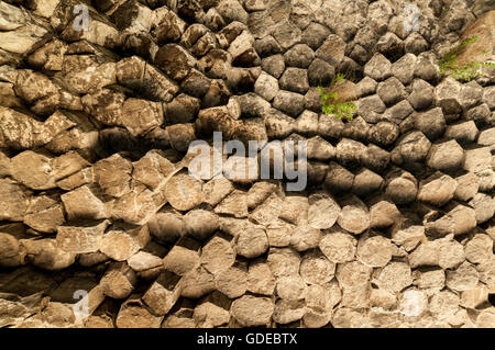 Hexagonal basalt pillars in Garni Gorge, Armenia - Stock Photo