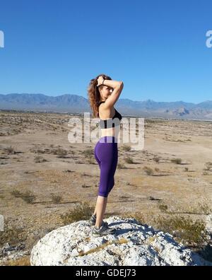 Woman hiker standing on rock, Nevada, America, USA - Stock Photo