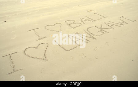 I love bali and langkawi written in sand on beach - Stock Photo