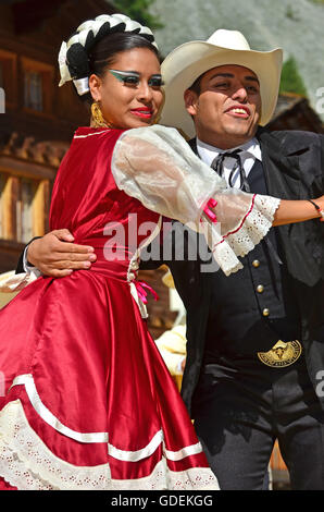 EVOLENE,SWITZERLAND - AUGUST 11: Two mexican dancers from Guadelupe Omexochitl in the CIME mountain culture Festival: - Stock Photo