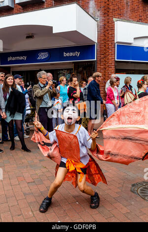 Local Schoolchildren Take Part In The Annual 'Moving On' Parade Through The Streets Of Lewes, Sussex, UK - Stock Photo