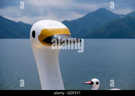 Swan boats at Lake Chuzenji in Nikko National Park, Japan. - Stock Photo