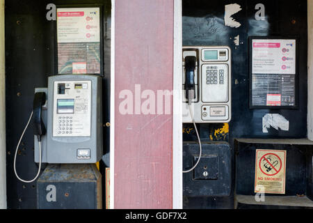 Two British Telecom public phones, one for cash and one card phone. - Stock Photo
