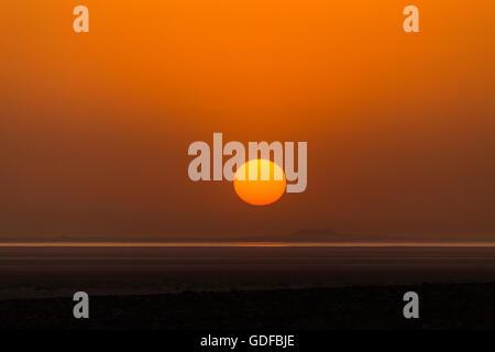 Sunrise over the Lake Assal, near Dallol, Danakil Depression, Afar Triangle, Ethiopia - Stock Photo