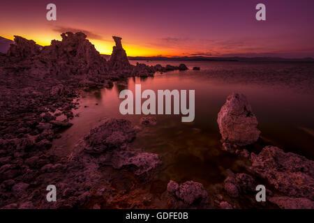 Calm Magenta Sunset Sky reflection in Mono Lake Inyo National Forest California, USA - Stock Photo