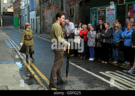 Irish re-enactment members stage an incident from the 1916 Easter uprising in Dublin Near Moore Street - Stock Photo