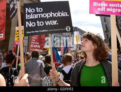 """People take part in a """"No More Austerity - No To Racism - Tories Must Go"""" demonstration organised by the - Stock Photo"""
