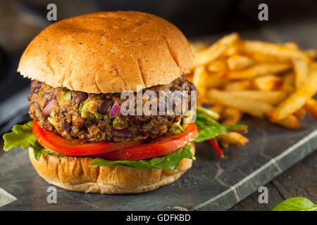 Vegan Homemade Portabello Mushroom Black Bean Burger with Fries - Stock Photo