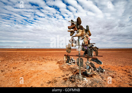 Funny shoe tree in the outback desert area of South Australia. - Stock Photo