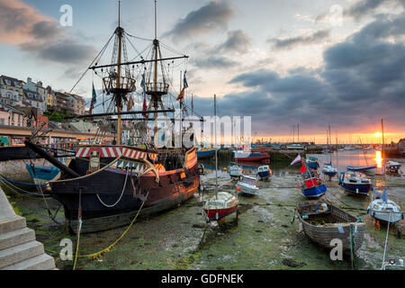 Stunning sunrise over a galleon in Brixham harbour on the south coast of Devon - Stock Photo