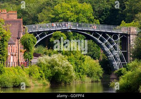 Tourists on the Iron Bridge over the River Severn at Ironbridge in Shropshire, England, UK. - Stock Photo