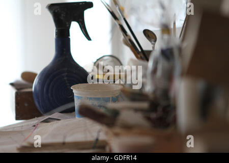 Set Of Dirty Art And Craft Sculpting Tools On Wooden Table In Pottery  Workshop   Stock