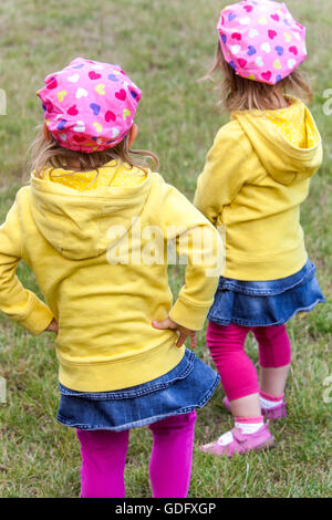 twins, girls at the same outfits - Stock Photo