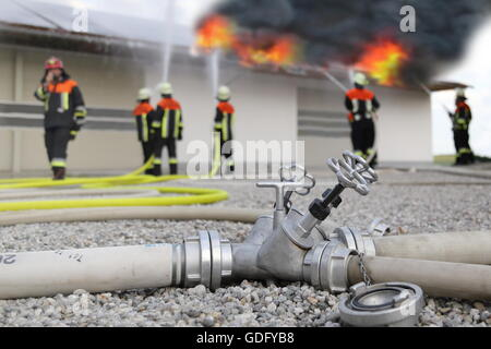 Firefighters solar roof panels photovoltaic on fire - Stock Photo