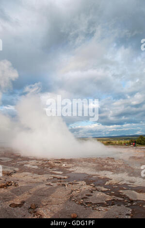 Iceland: the eruption of the Great Geyser, in the Geysir area, home to the famous geysers, a periodically spouting - Stock Photo