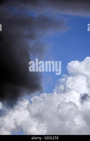 Cumulus congestus / towering cumulus cloud turning into Cumulonimbus calvus and black rain cloud covering the blue - Stock Photo