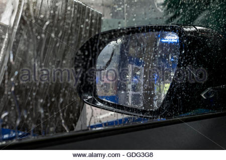 Carwash through window showing mirror water - Stock Photo
