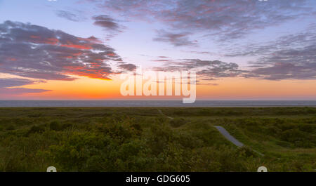 Pastel sunset at Schiermonnikoog, one of the West Frisian islands in the Wadden Sea, Friesland, The Netherlands. - Stock Photo