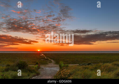 A fiery sunset on the beach of Schiermonnikoog, one of the West Frisian islands in the Wadden Sea, Friesland, The - Stock Photo
