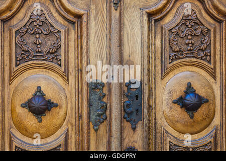 Carved wooden double door with an antique lock on a house in Fribourg, Switzerland - Stock Photo