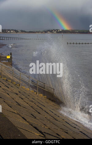 Rainbow and wave - Stock Photo