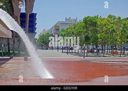 LISBON, PORTUGAL - JUNE 16, 2015: Marvelous cityscape view of waterfall in the Water Gardens located at the Park - Stock Photo
