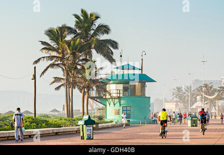 DURBAN, SOUTH AFRICA - APRIL 16, 2016: Locals and tourists near the lifesaver's station on The Golden Mile promenade - Stock Photo
