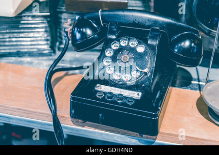 Black vintage Rotary Phone with toned effect - Stock Photo