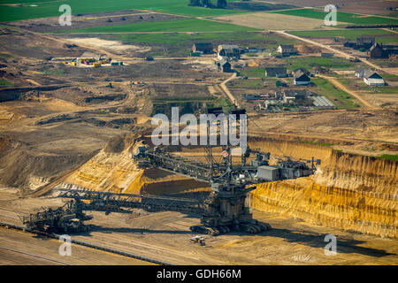 Aerial view, coal excavator in front of the destroyed Borschemich district, coal mine Garzweiler, Erkelenz, Niederrhein - Stock Photo