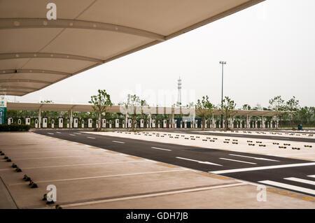 Parking spots at an EV charging station, number 4 car park Shanghai Disneyland, China. - Stock Photo