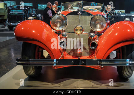 Mercedes-Benz Museum interior, Stuttgart, Germany. Grill, headlights, badge and logo of old veteran car - Stock Photo