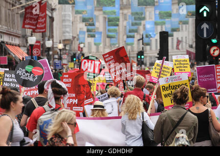 London, UK. 16th July, 2016: Hundreds of people take part in a demonstration outside the BBC offices at Portland Place and march to Parliament Square WC1, united in demanding for an end to Austerity, No To Racism and demanding and end to the Tory rule. The demonstration on 16 July called by the People's Assembly and Stand Up to Racism is the positive and united response After the Brexit referendum. Credit:  david mbiyu/Alamy Live News