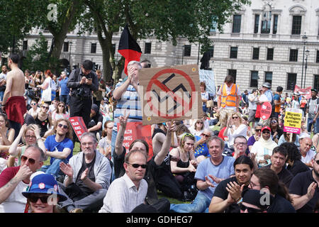 LONDON, UK - JULY 16: Hundreds of people take part in a demonstration outside the BBC offices at Portland Place - Stock Photo