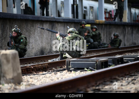Rio De Janeiro, Brazil. 16th July, 2016. Soldiers attend a drill on external attack at the Deodoro Station as preparations - Stock Photo