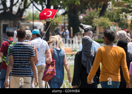 Istanbul, Turkey. 17th July, 2017. Tourist follow a guide with a turkish flag at the historic center in Istanbul, - Stock Photo