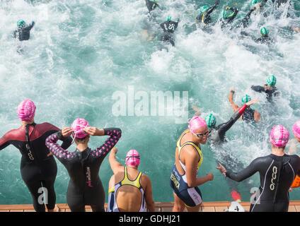 Triathlon open water sea swim start. - Stock Photo