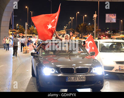 Istanbul, Turkey. 17th July, 2016. People wave Turkish flags as they head for a rally in support of Turkish President - Stock Photo