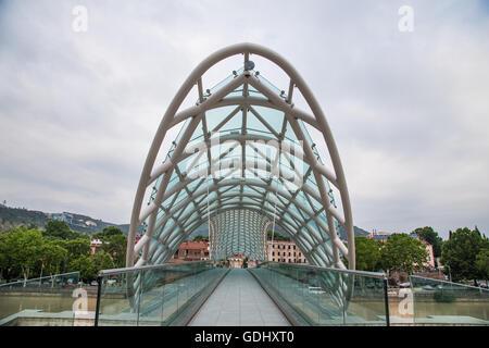 Bridge of Peace over river Mtkvari in Tbilisi, Georgia - Stock Photo