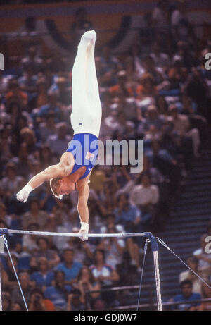 Bart Conner of USA performs on horizontal bar at 1984 Olympic Games in Los Angeles. - Stock Photo
