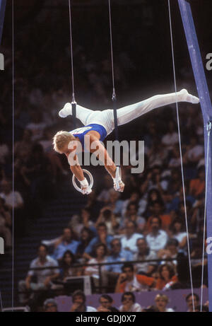 Bart Conner of USA performs on rings at 1984 Olympic Games in Los Angeles. - Stock Photo