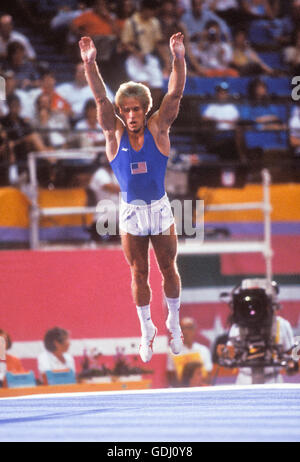 Bart Conner of USA performs on floor exercises at 1984 Olympic Games in Los Angeles. - Stock Photo