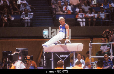Bart Conner of USA performs on pommel horse at 1984 Olympic Games in Los Angeles. - Stock Photo