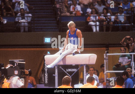Bart Conner of USA performs on pommel horse during gymnastics competition at 1984 Olympic Games in Los Angeles. - Stock Photo