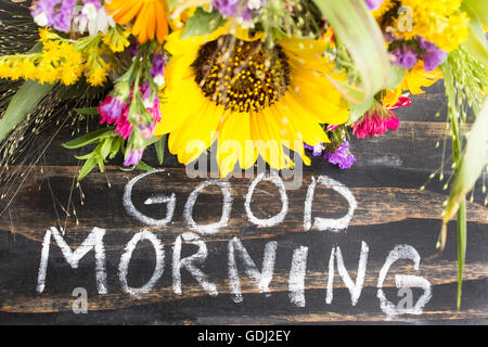 Words Good Morning with Summer Flowers on a Rustic Wooden Background. - Stock Photo