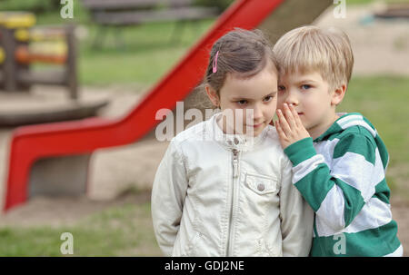 Friends are playing on the playground - Stock Photo