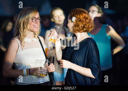 Girls in the audience during music concert at Festival Lent, Maribor, Slovenia, 2016 - Stock Photo
