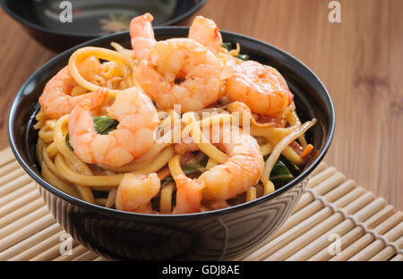 Prawn Chow Mein or Lo Mein stir fried prawns with egg noodles vegetables and bean sprouts - Stock Photo