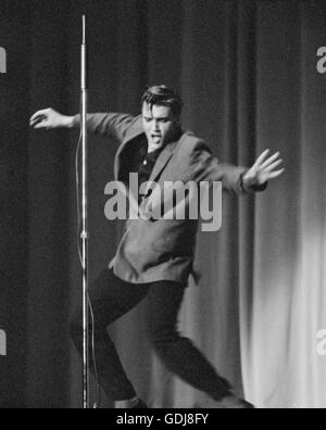 Elvis Presley, performing on stage, May 26, 1956. - Stock Photo