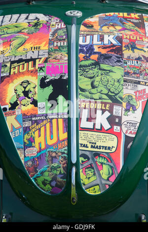 Incredible hulk comic covers on the bonnet of an old VW Beetle car at a VW show Oxfordshire, England. Front end - Stock Photo